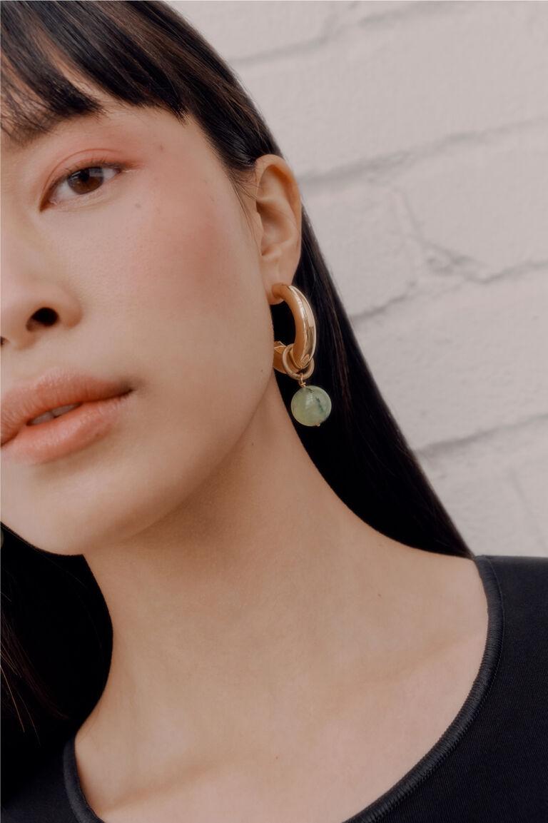 Model wearing Crescent Hoop Earrings with Prehnite Embellishment