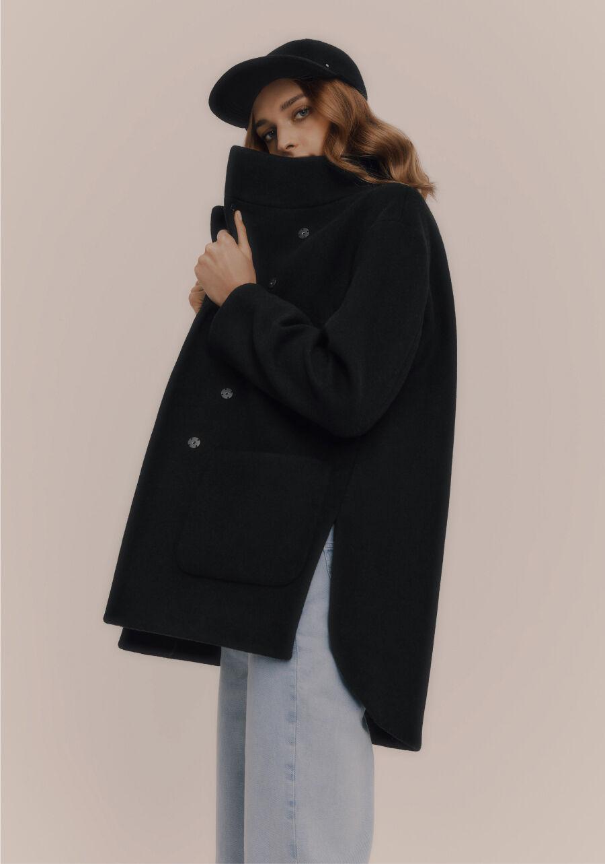 Model wearing Cuyana Wool High-Low Jacket and Wool Baseball Cap