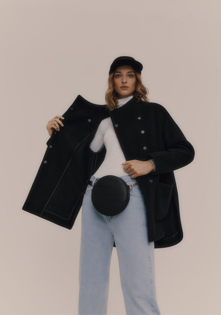 Model wearing Wool High-Low Jacket with Mini Circle Belt Bag