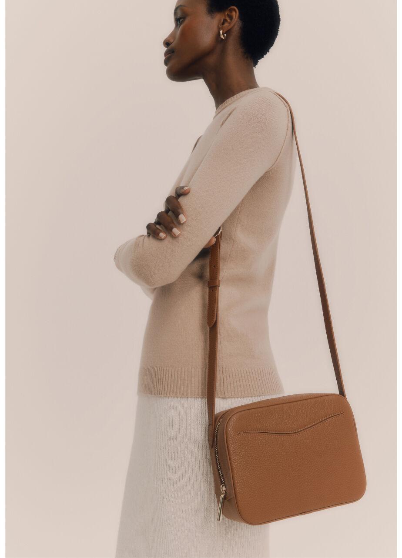 Model wearing Camera Bag