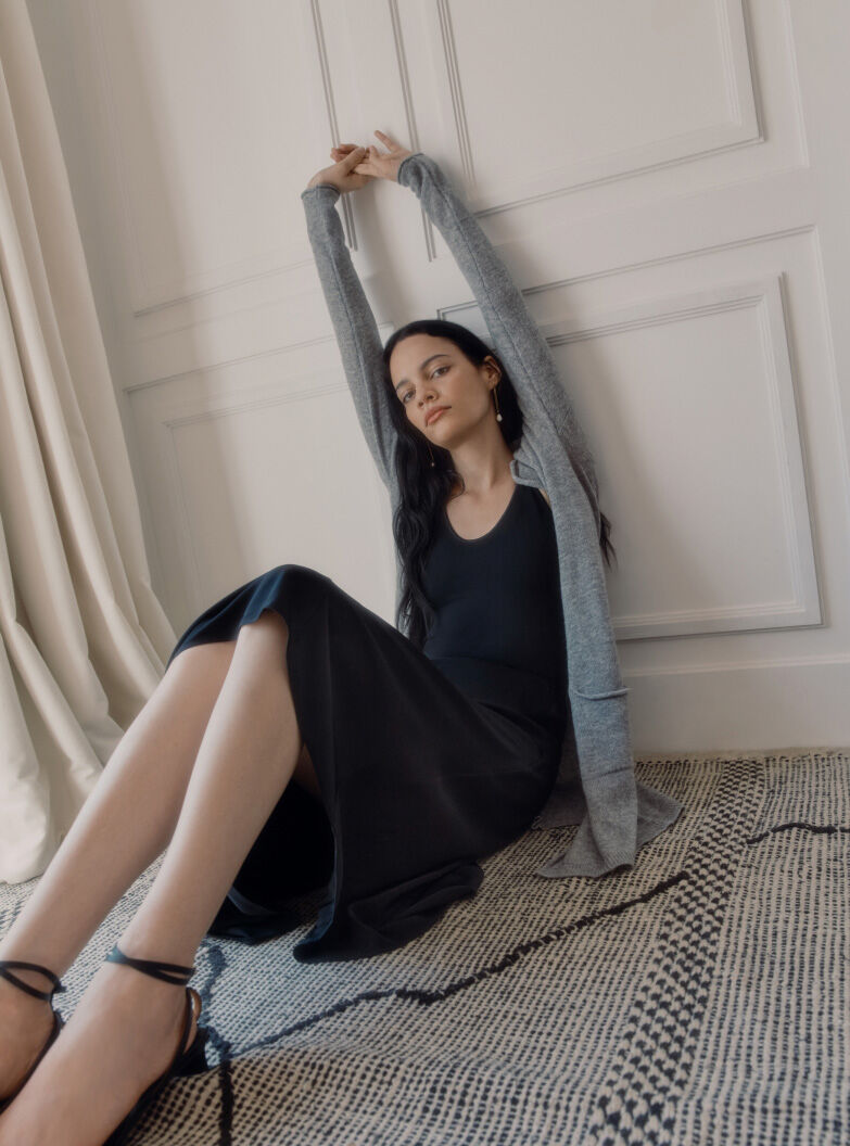 Model in Cuyana Silk Skirt and Cashmere Cardigan