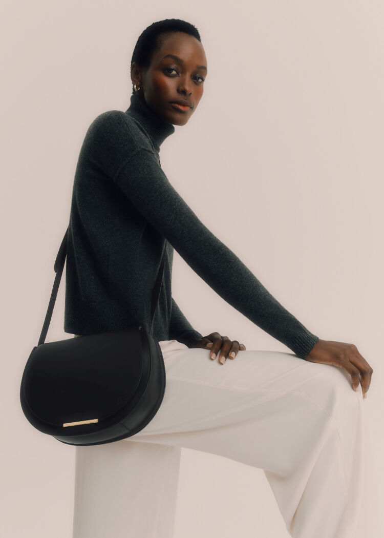 Model in Cuyana Sweater with Saddle Bag