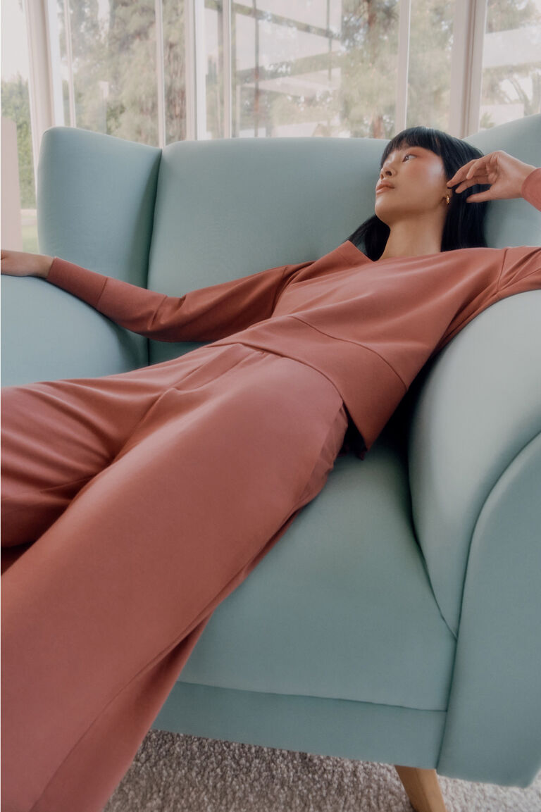 Model lounging in French Terry