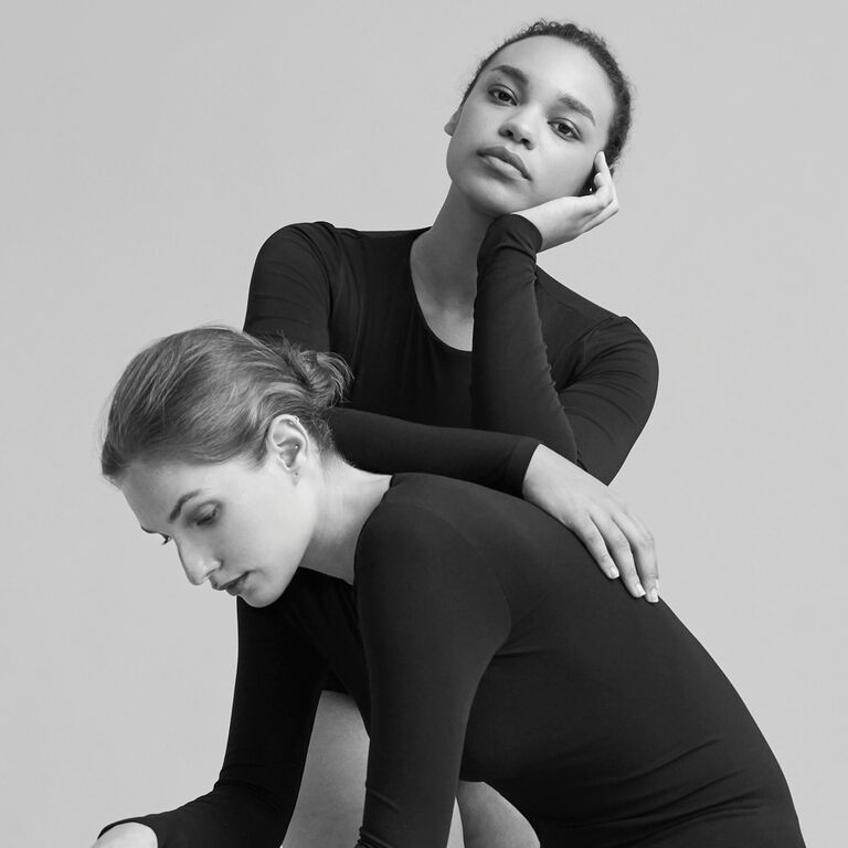 Two models wear Cuyana bodysuits