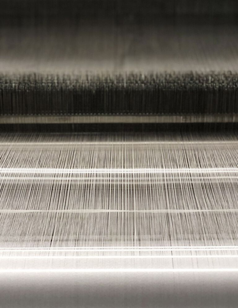 Silk threads being turned into fabric