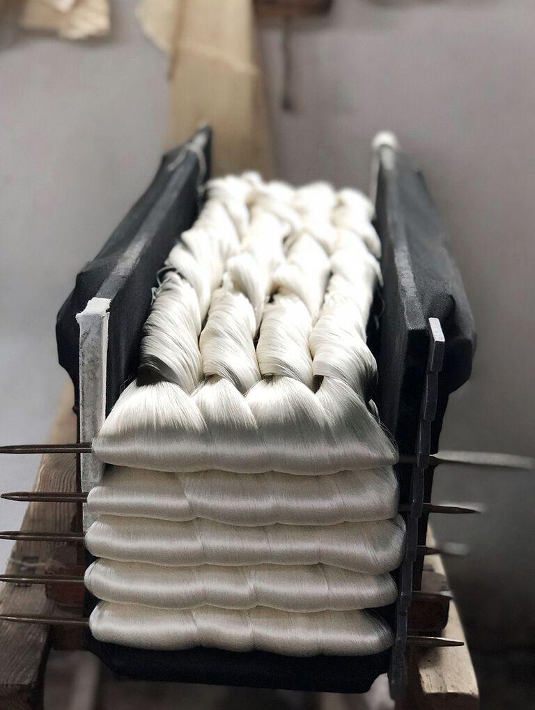white silk threads shown braided in their factory setting