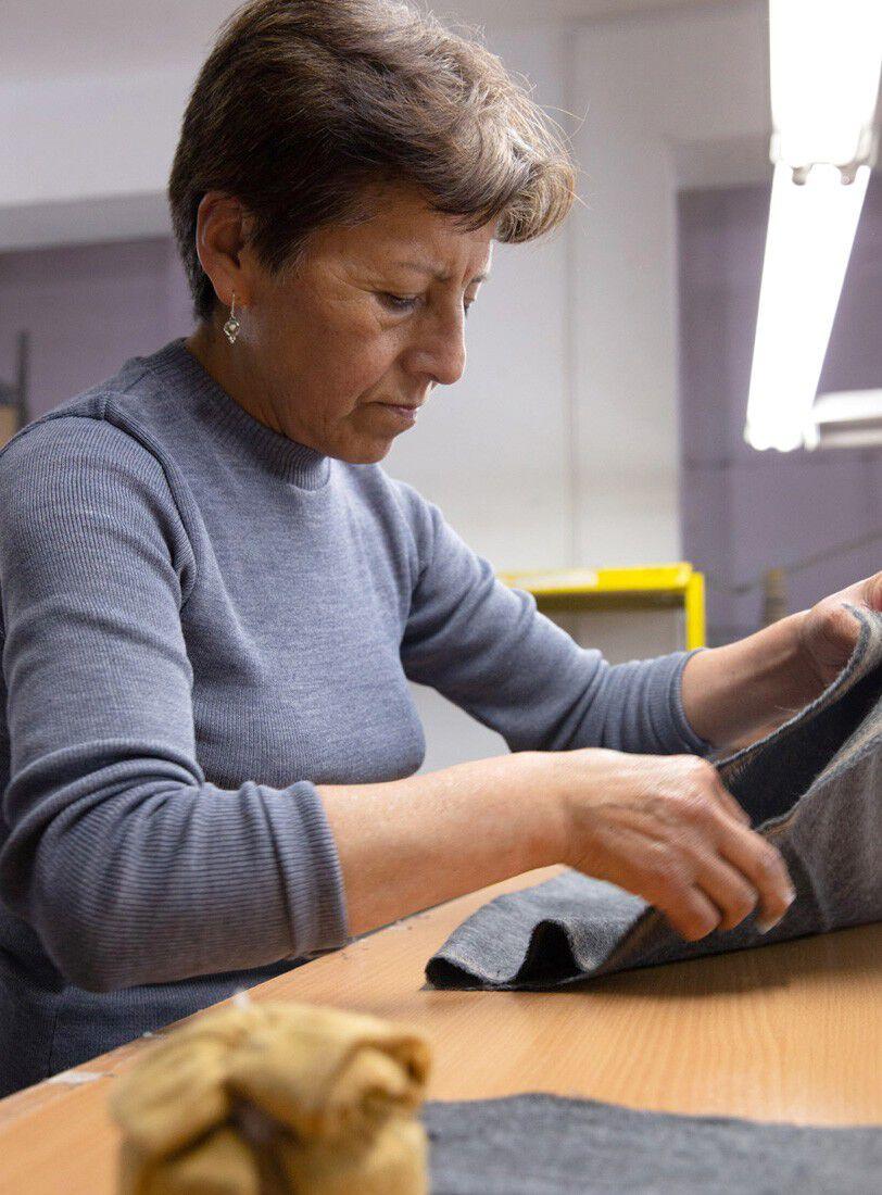 Woman weaving alpaca fibers