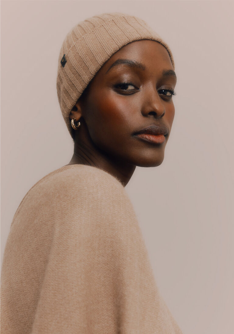 Model wearing Cuyana Beanie and Sweater