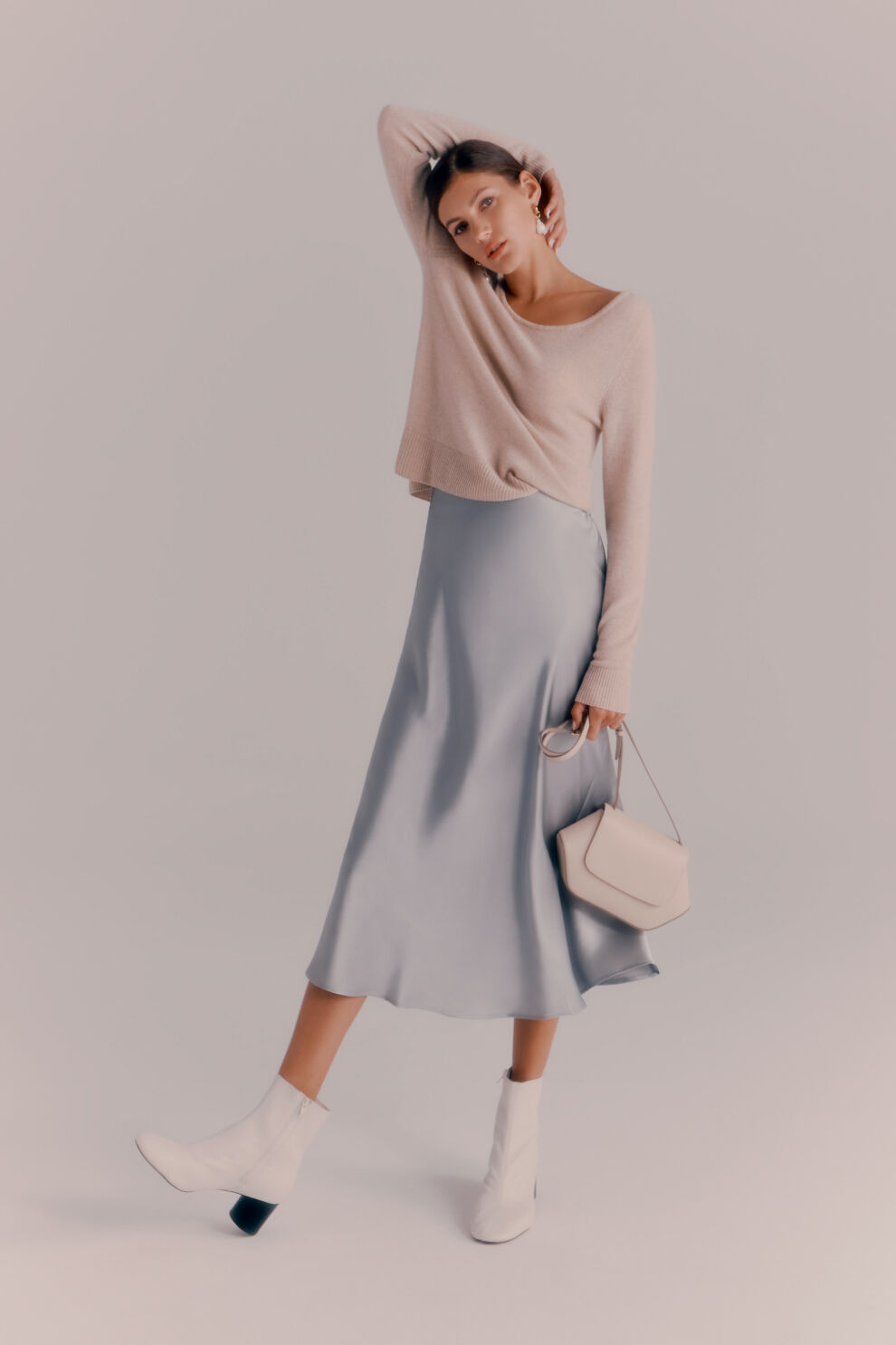 Cuyana Single Origin Cashmere Scoop Neck Sweater worn with Charmeuse Midi Skirt, Mini Hoop Earrings and Baroque Pearl Embellishment, and Hexagon Crossbody