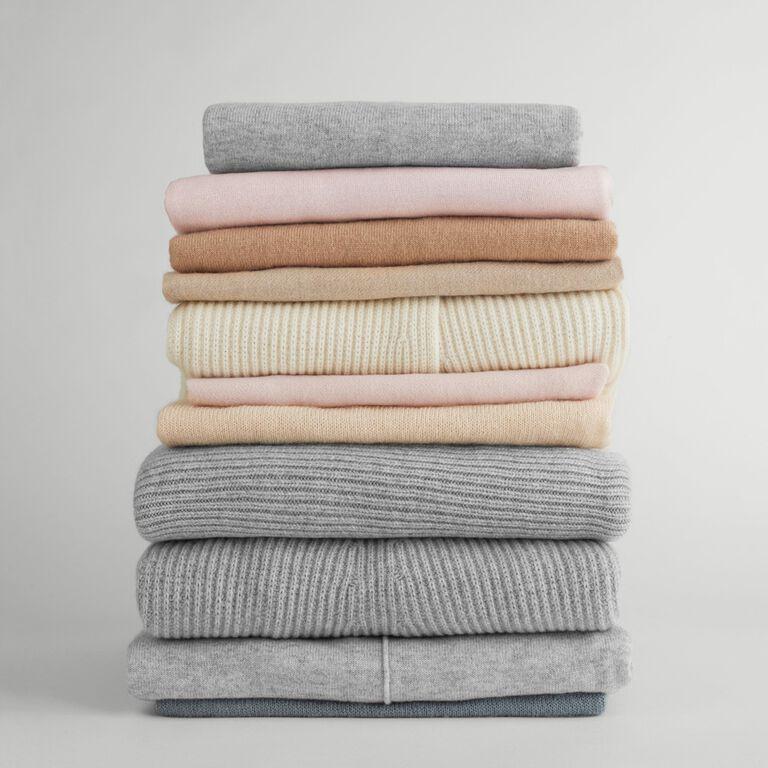 Stack of folded Cuyana clothing