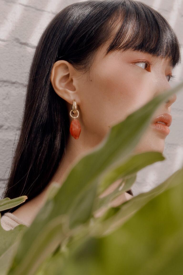 Model wearing Mini Hoop Earrings with Carnelian Embellishment