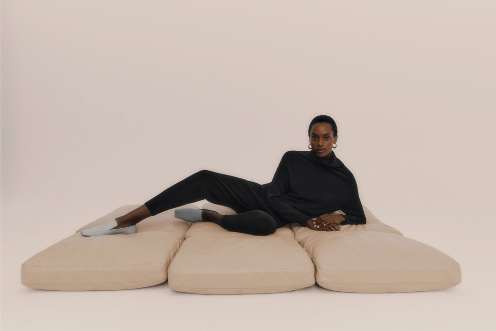 Model lounging in Cuyana Cashmere