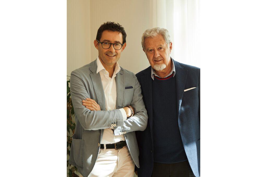 Two men in blazers