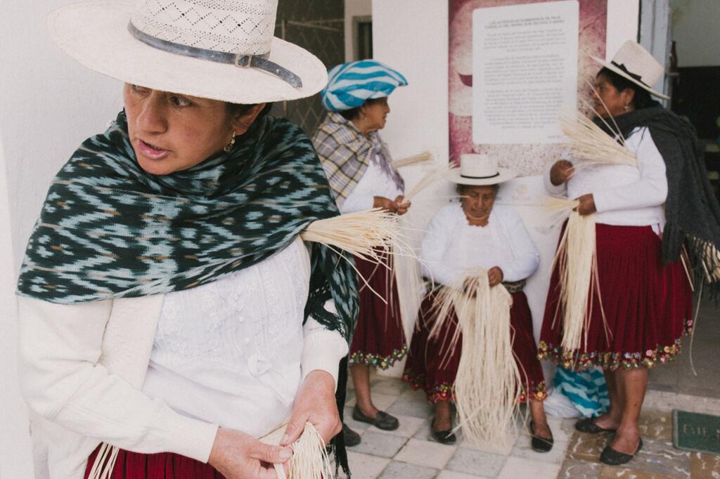 Women weaving toquilla straw