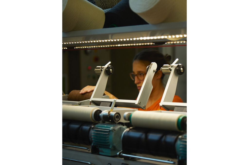 Woman weaving cashmere fibers
