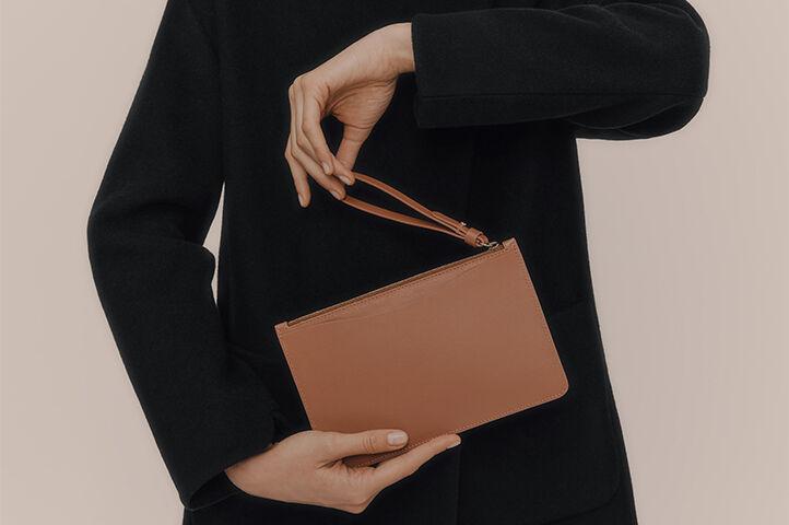 Model wearing Slim Wristlet Wallet