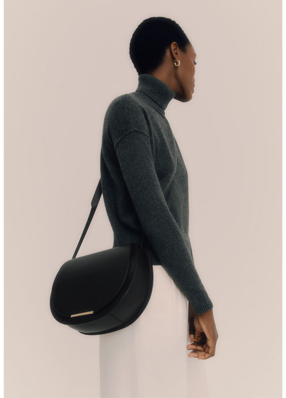 Model with Cuyana Saddle Bag