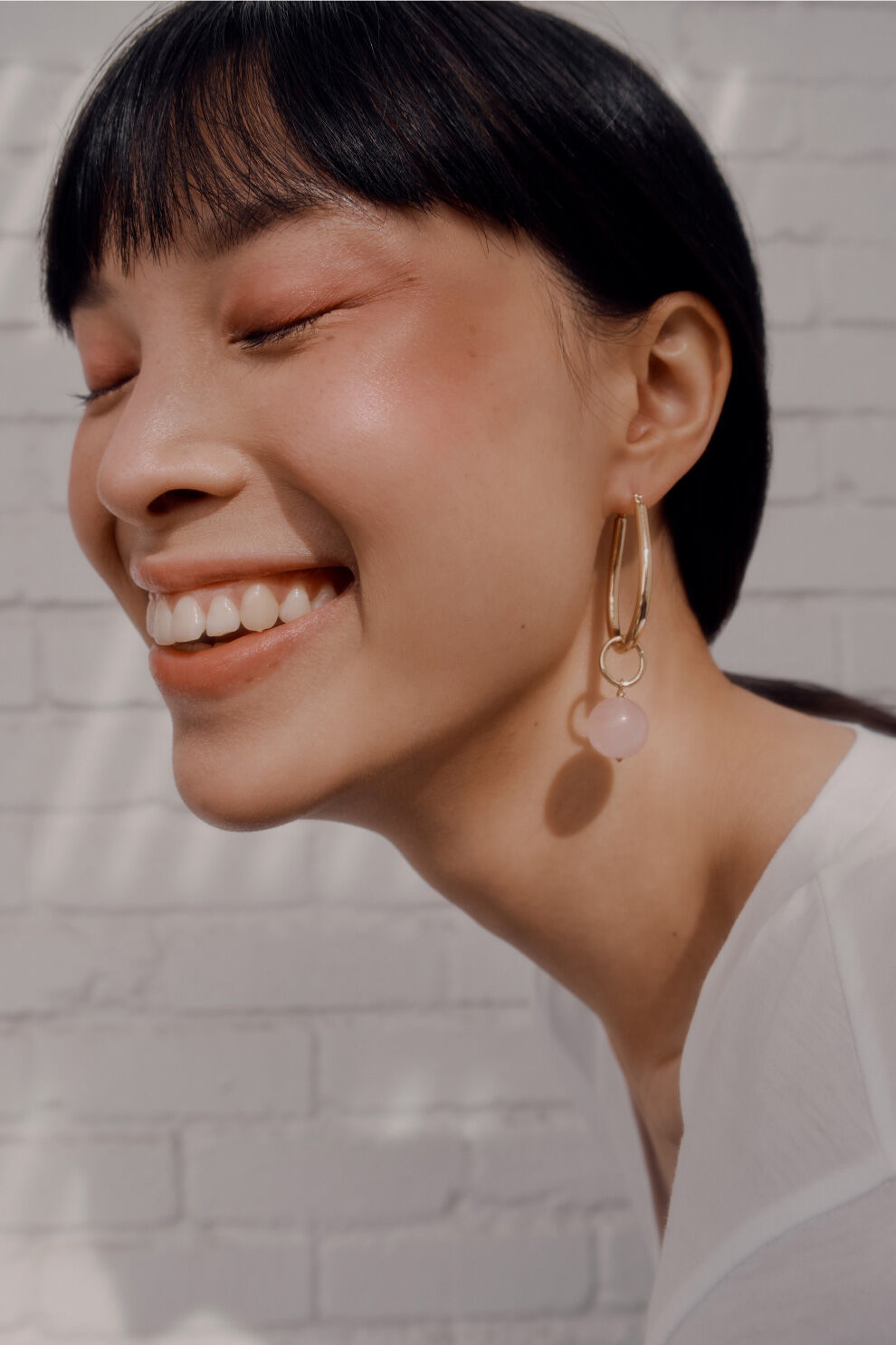 Model wearing Petal Hoop Earring with Rose Quartz Embellishment