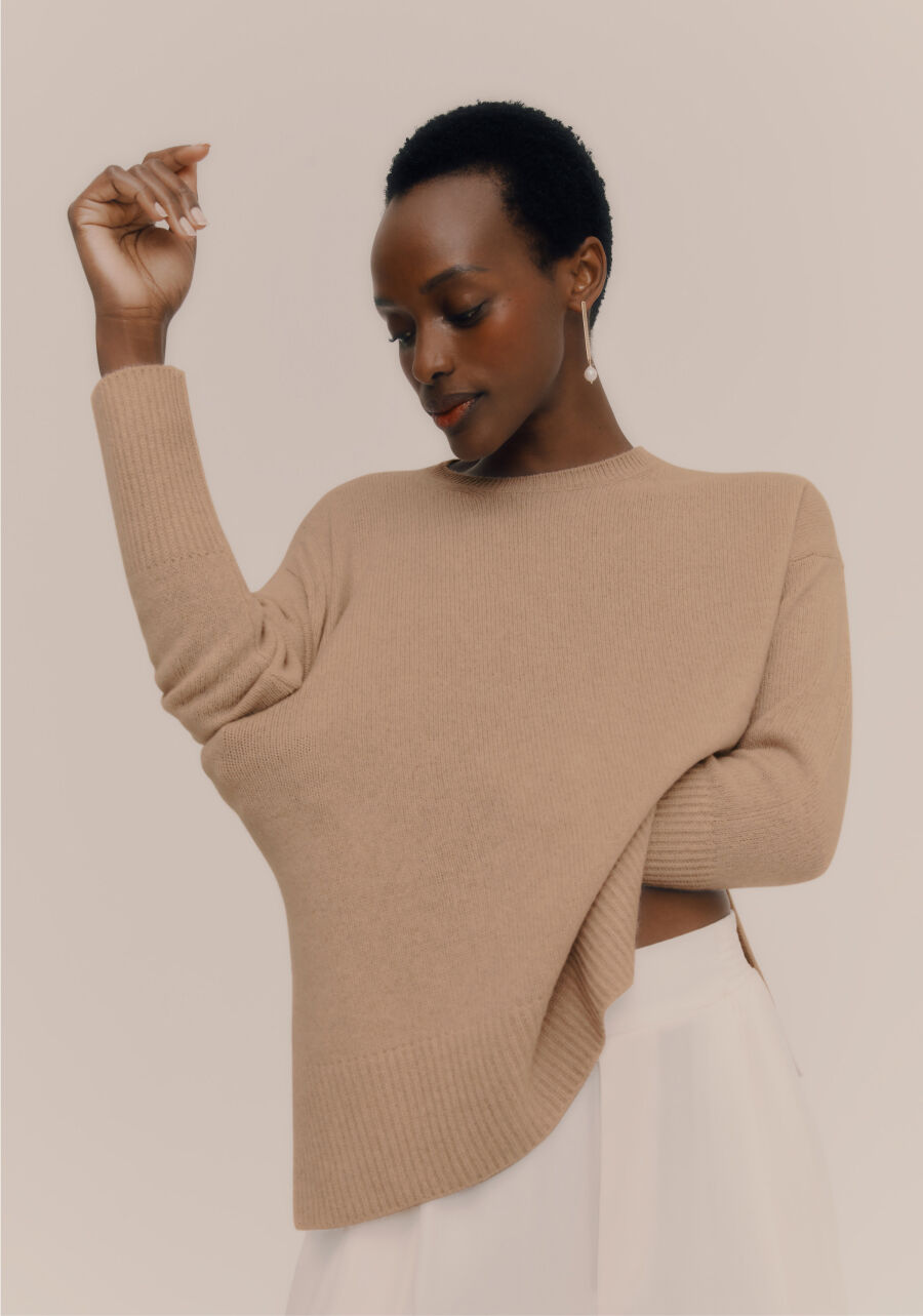 Model wearing Cuyana Cashmere Sweater and Pearl Drop Earrings