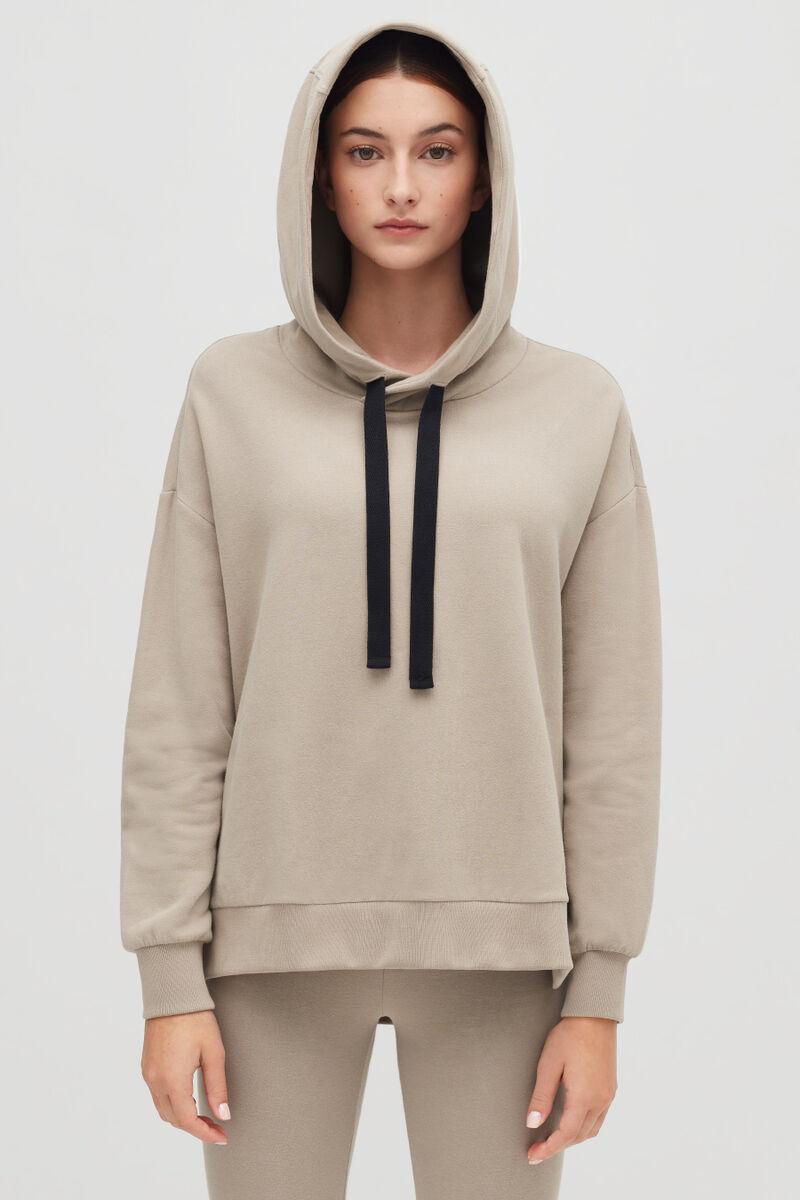 Stone Fleece Hoodie on model with hood up