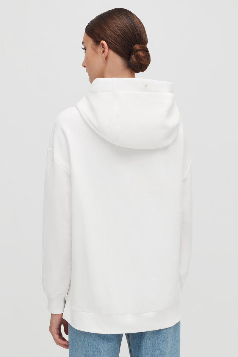 White Fleece Hoodie on model with hood down from back