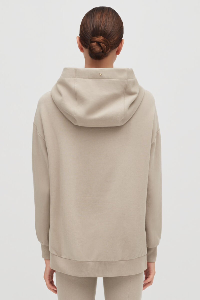 Stone Fleece Hoodie on model with hood down from back