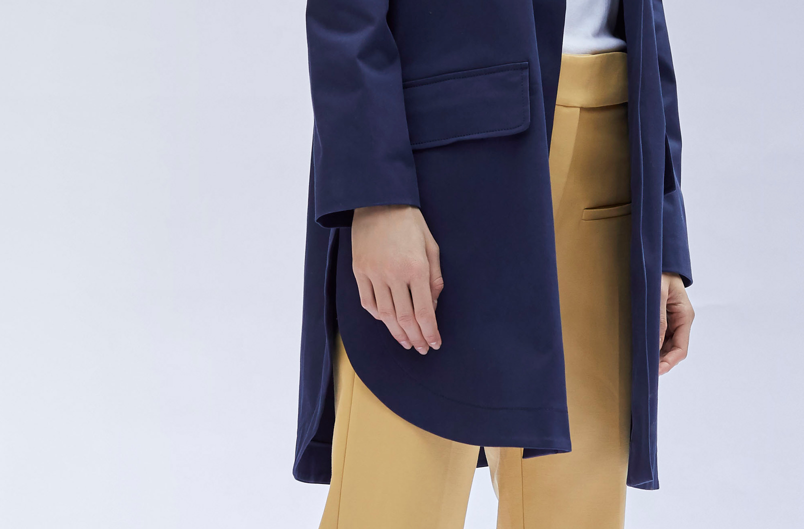 Detail shot of shirttail hem of Pleat-Back Anorak
