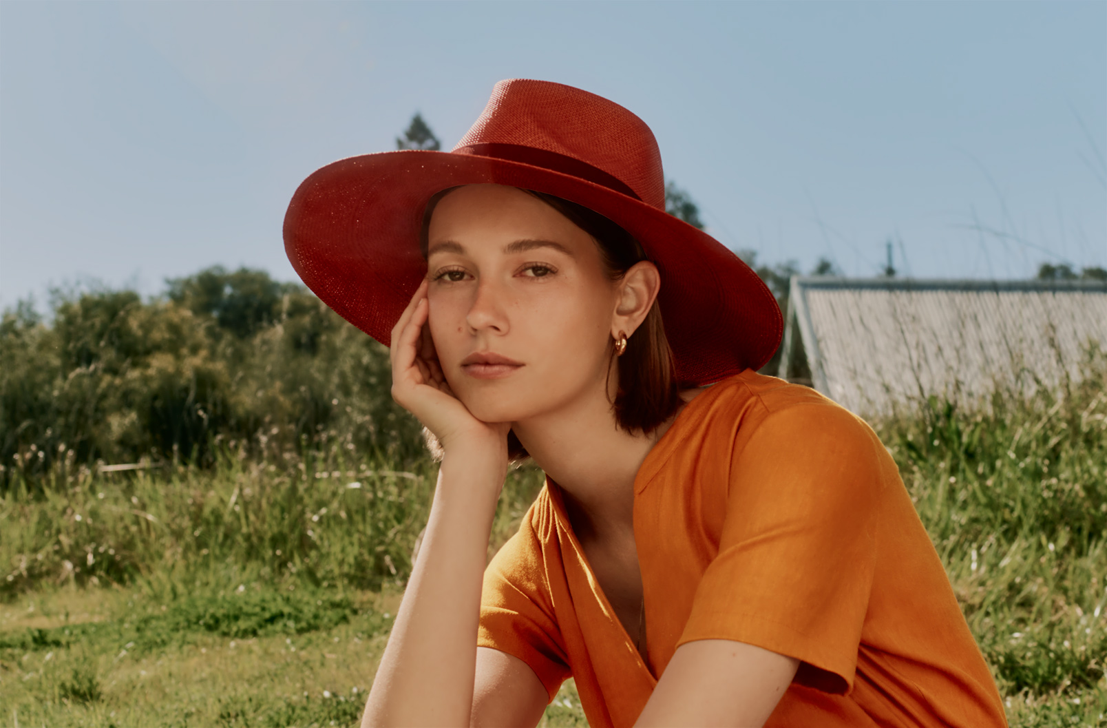 model wearing Ribbon Tie Summer Hat in rust without ribbon