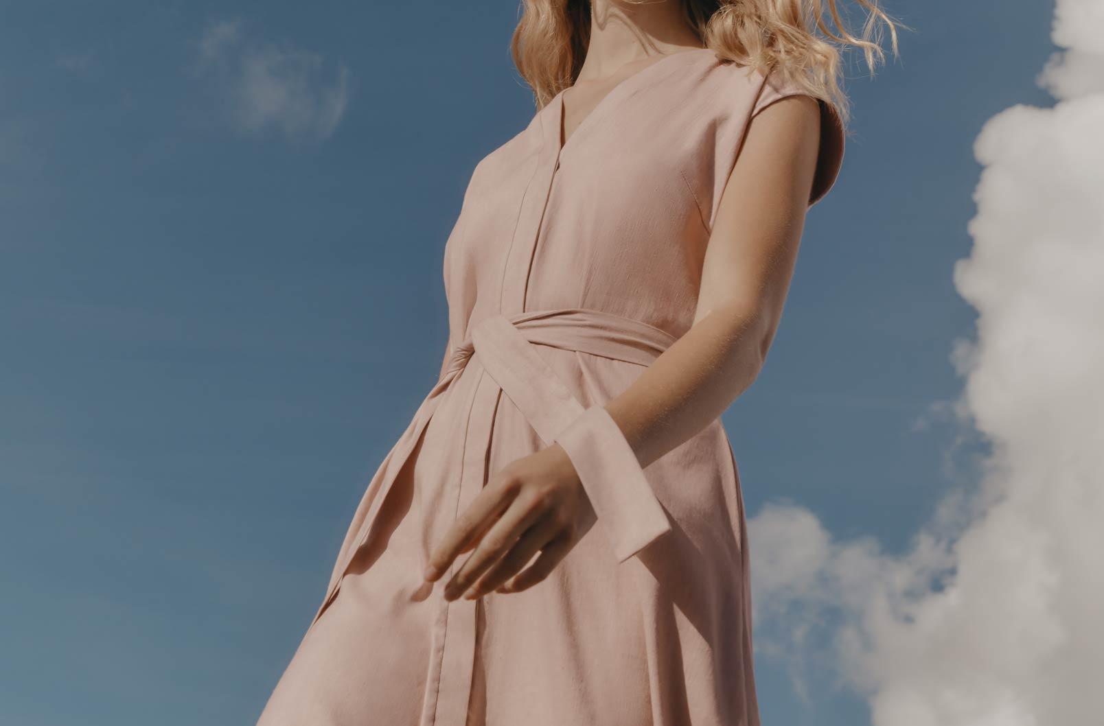 Model wearing Linen Button Front Dress showing hidden placket