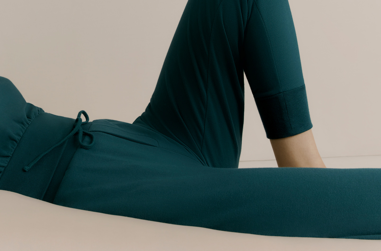 Model lounging in French Terry Tapered Lounge Pant