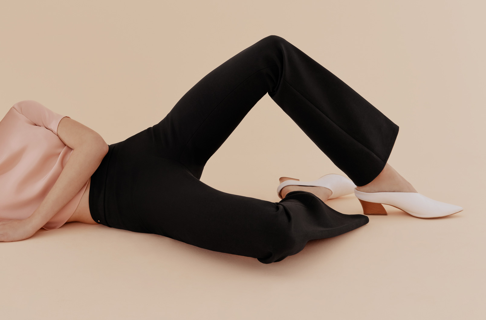 Model lying wearing Cotton Twill Flared Pant