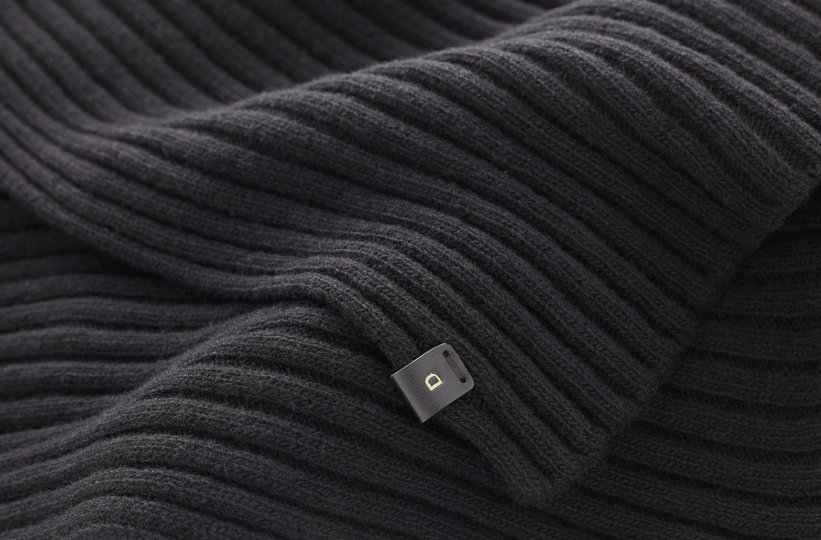 Detail shot of monogrammed scarf