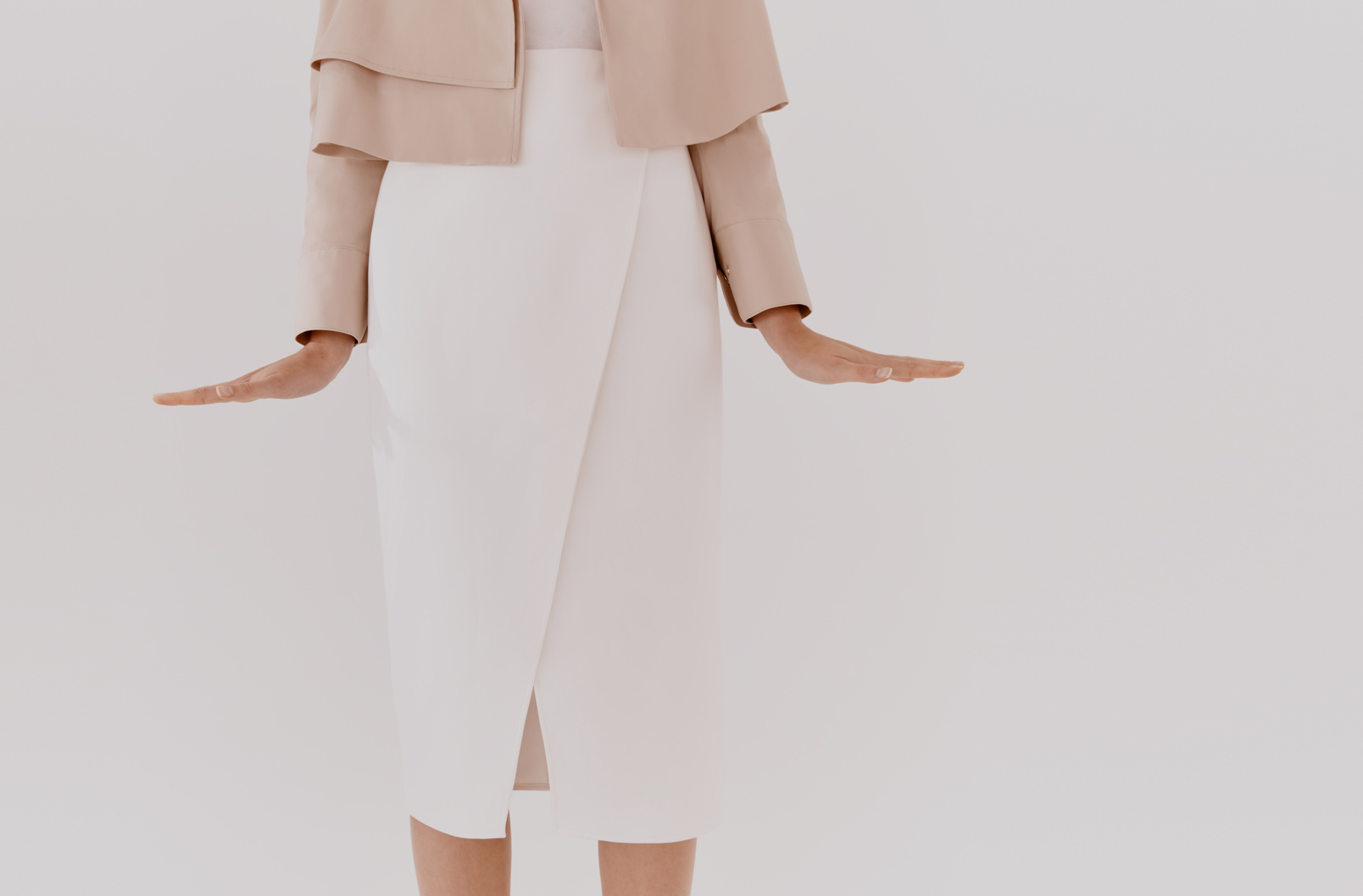 Detail shot of the Cotton Twill Paneled Skirt on a model