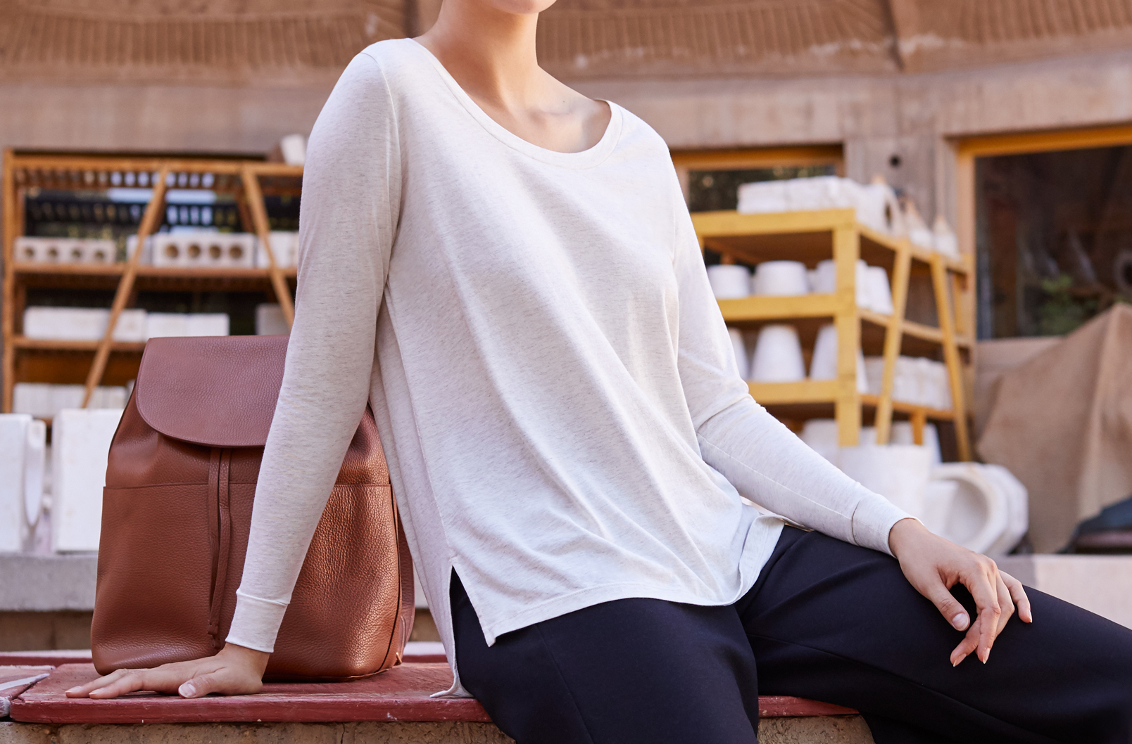 Model wearing Cuyana Long Sleeve Scoop Neck Tee