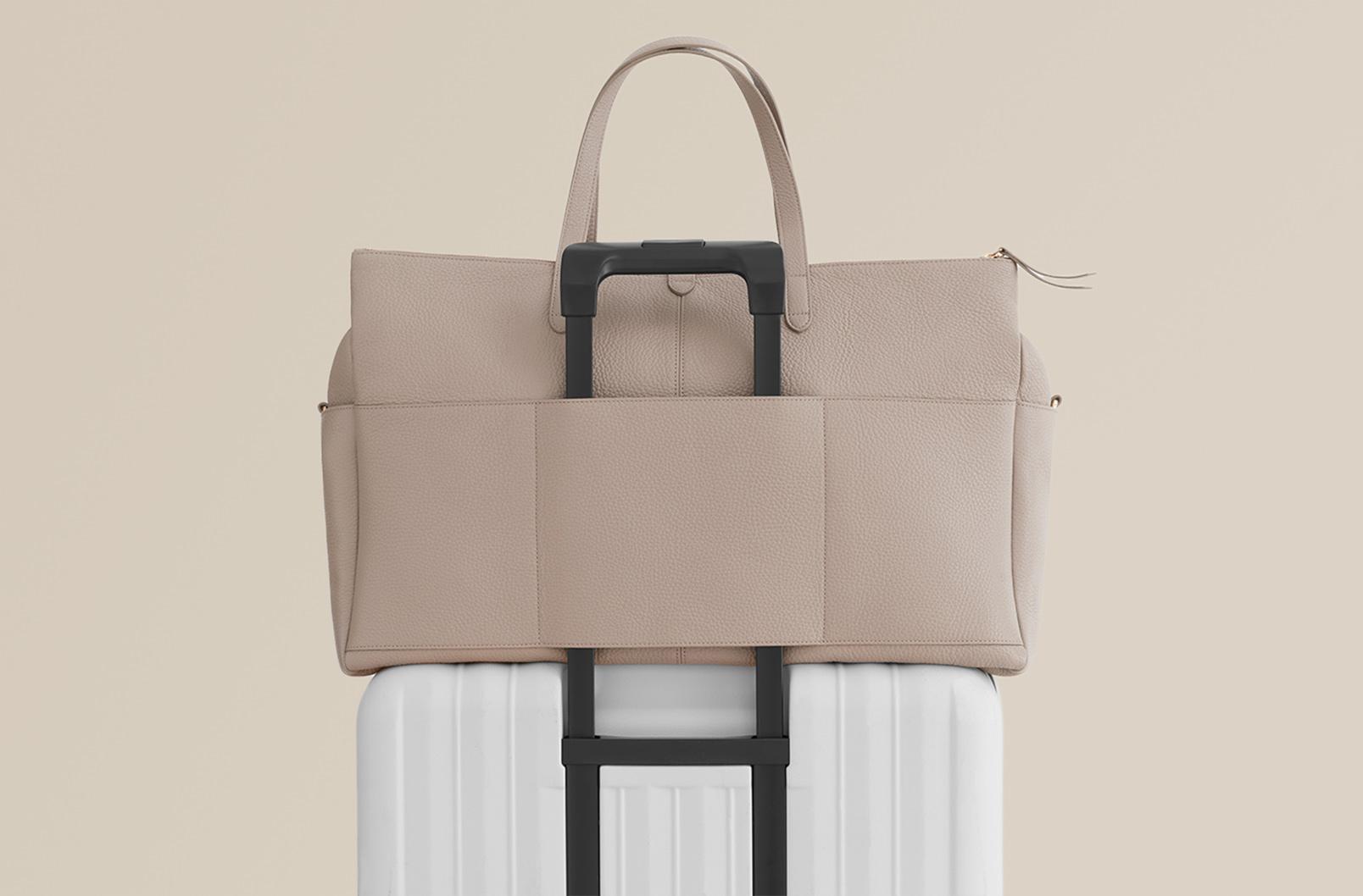 Cuyana Leather Triple Zipper Weekender luggage sleeve
