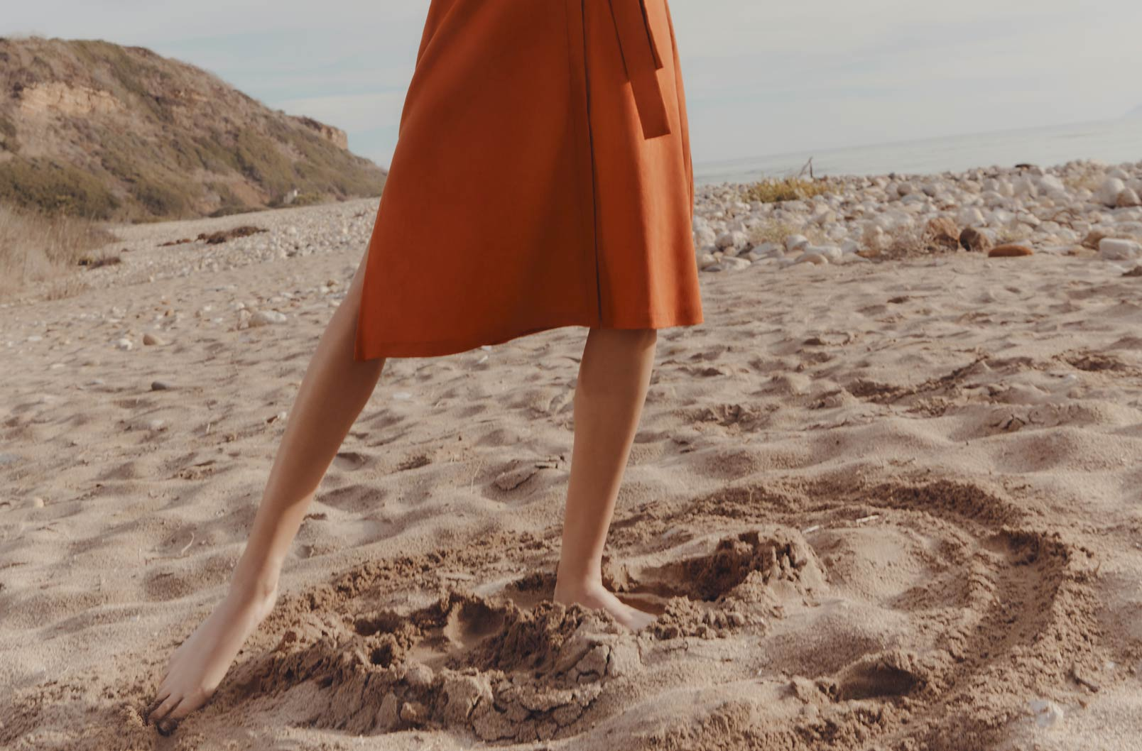 Image showing bottom of Linen Button Front Dress on model on beach