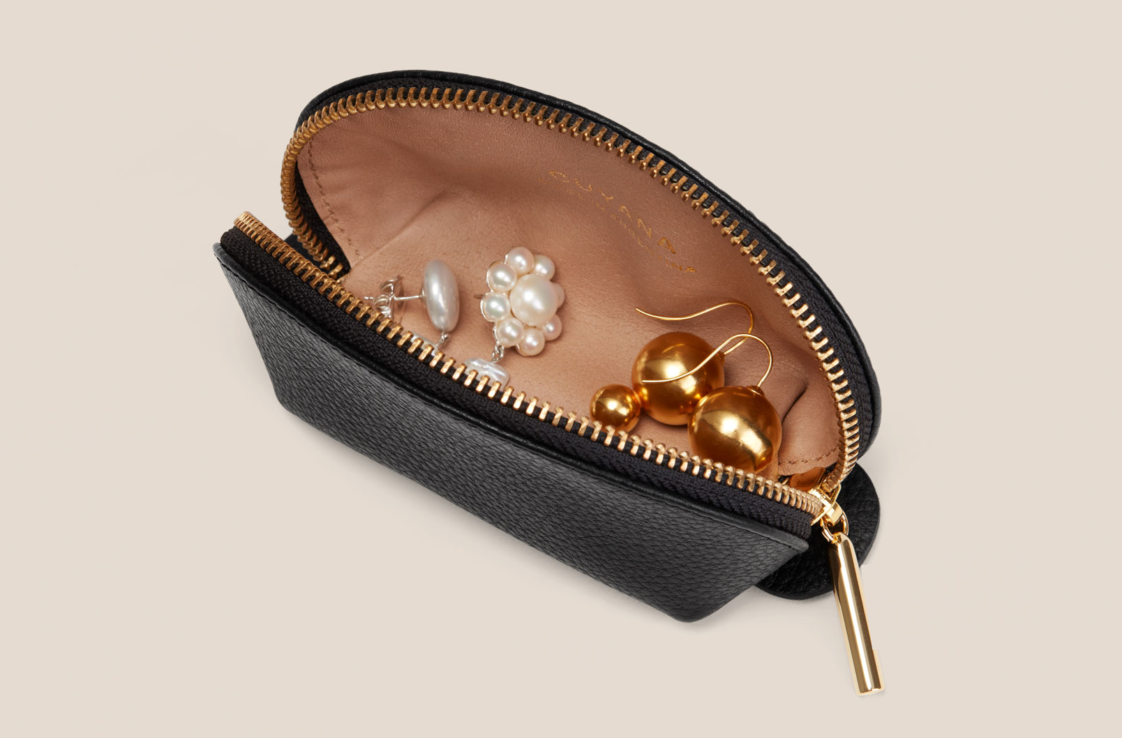 Cuyana Mini Travel Case in Black with earrings inside