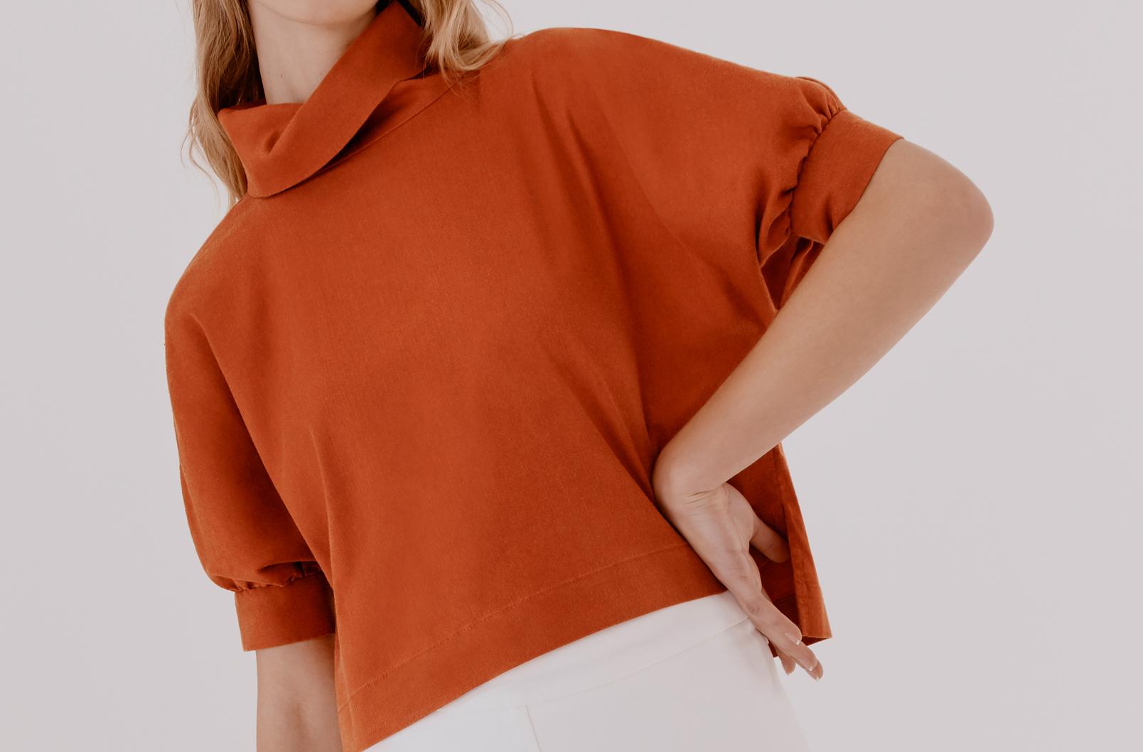 Woman wearing Linen Dolman Sleeve Top