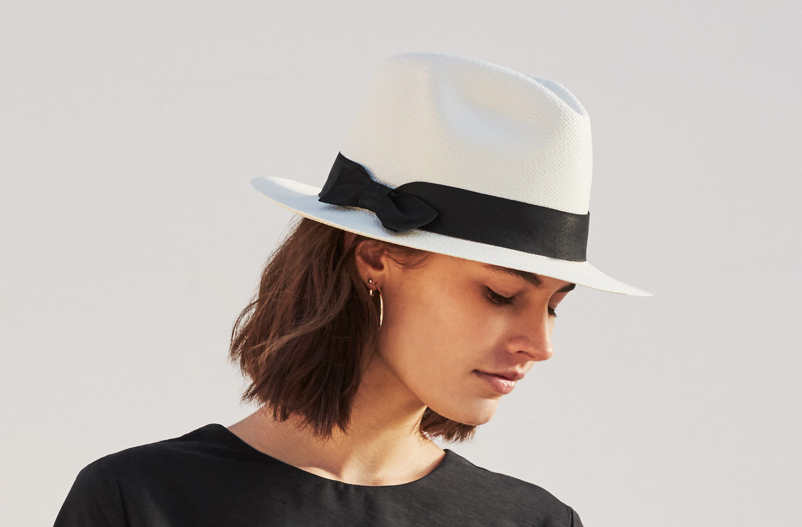 Model wearing Cuyana Panama Hat