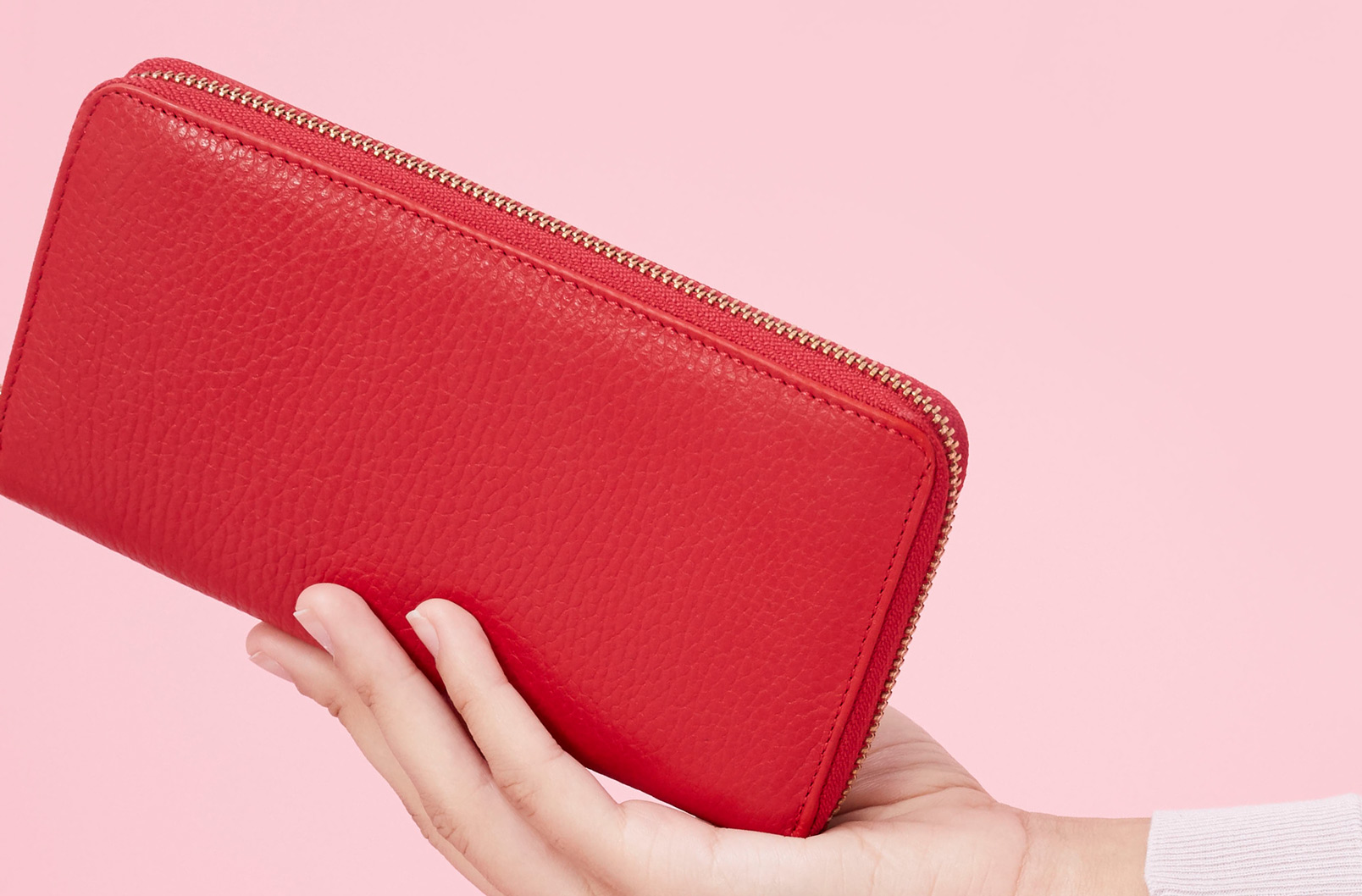 Woman holding Classic Zip Around Wallet in Red