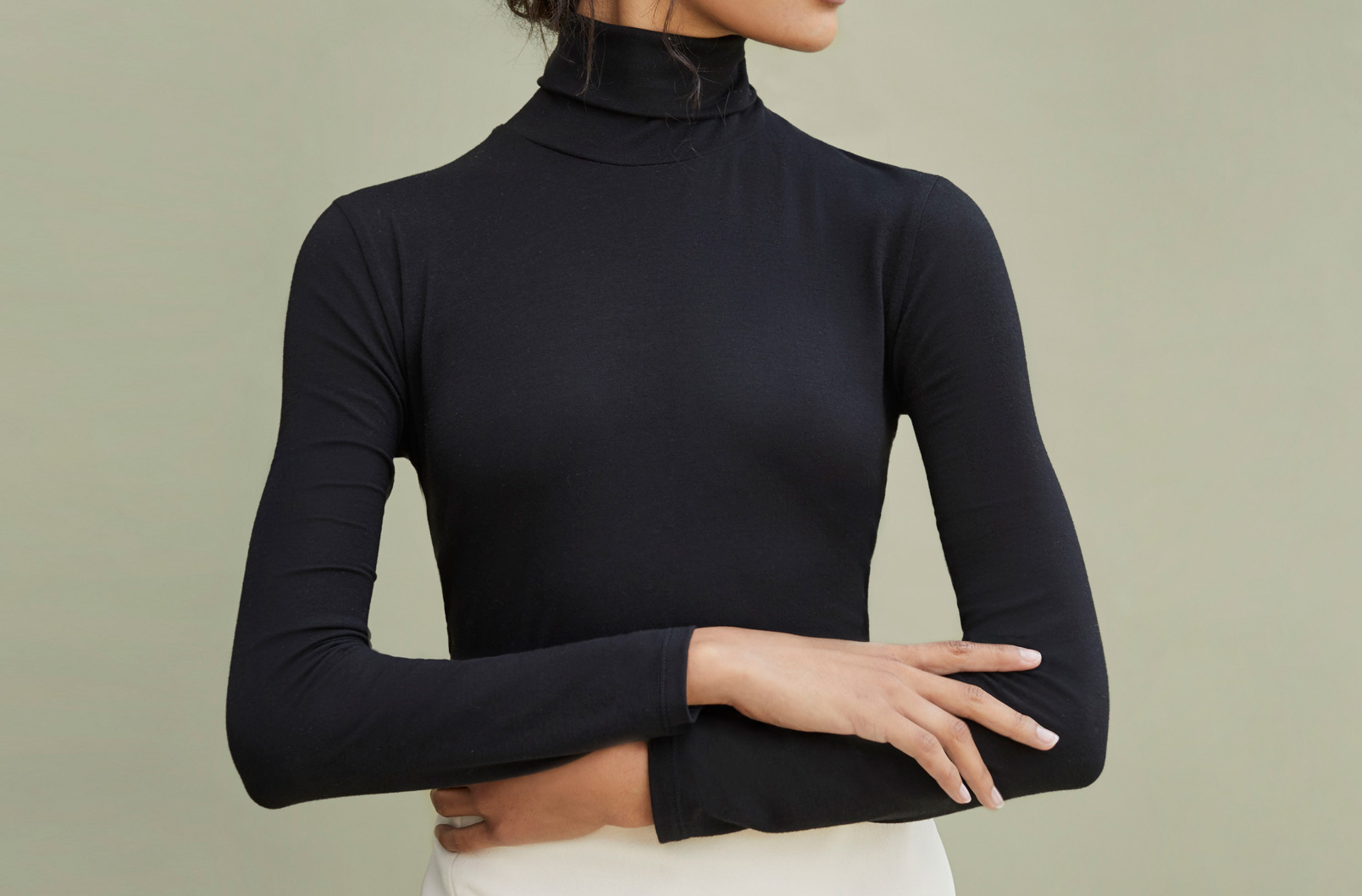 Model wearing Cuyana Slim Turtleneck Long Sleeve Tee