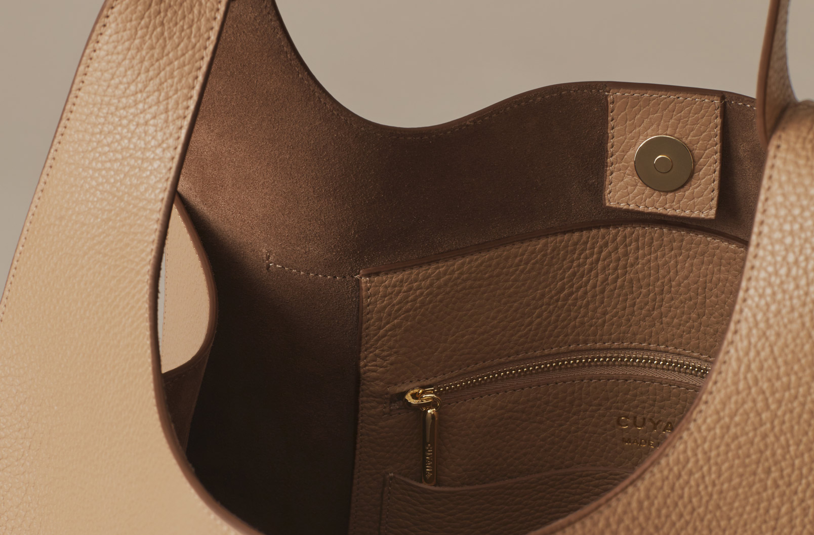 Detail shot of suede interior and magnetic closures of Cuyana Oversized Hobo