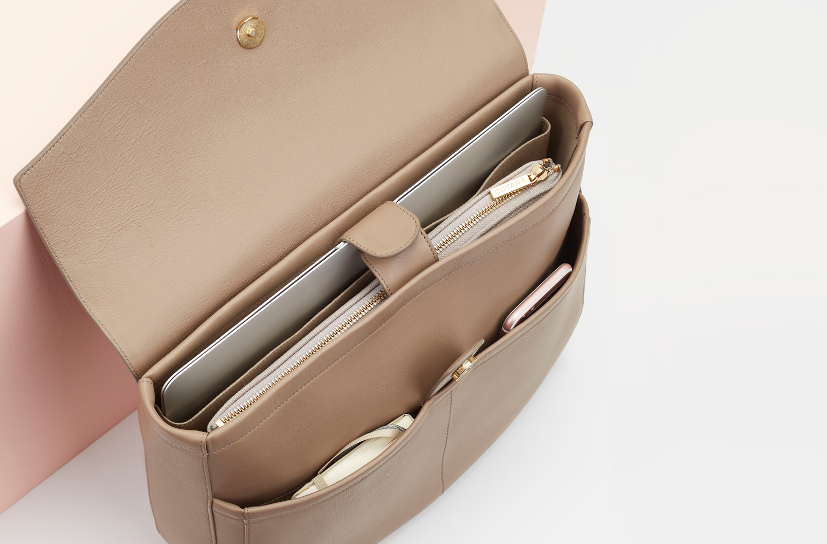 Interior image showing laptop inside Convertible Satchel with pocket option