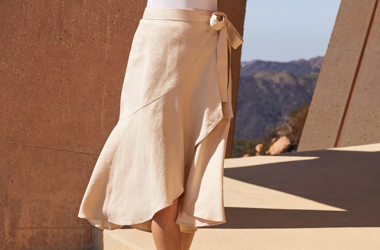 Model wearing Cuyana Linen Ruffle Wrap Skirt