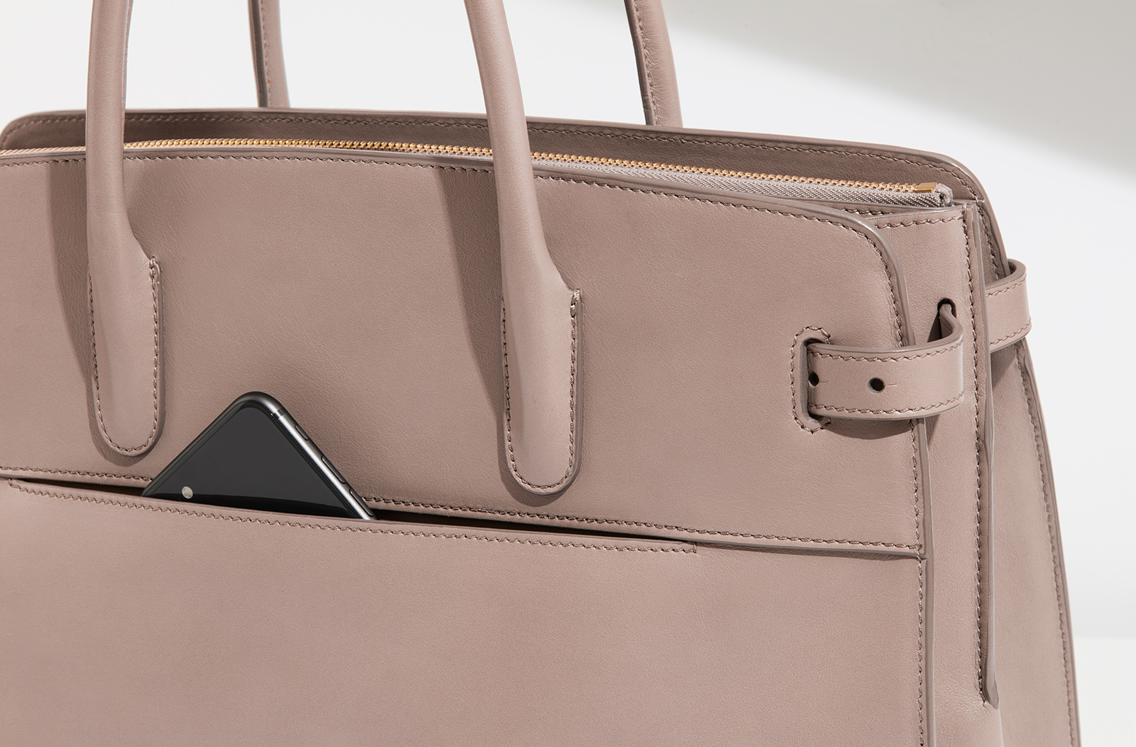 Slip pockets on exterior of Work Satchel allows for easy access to a phone
