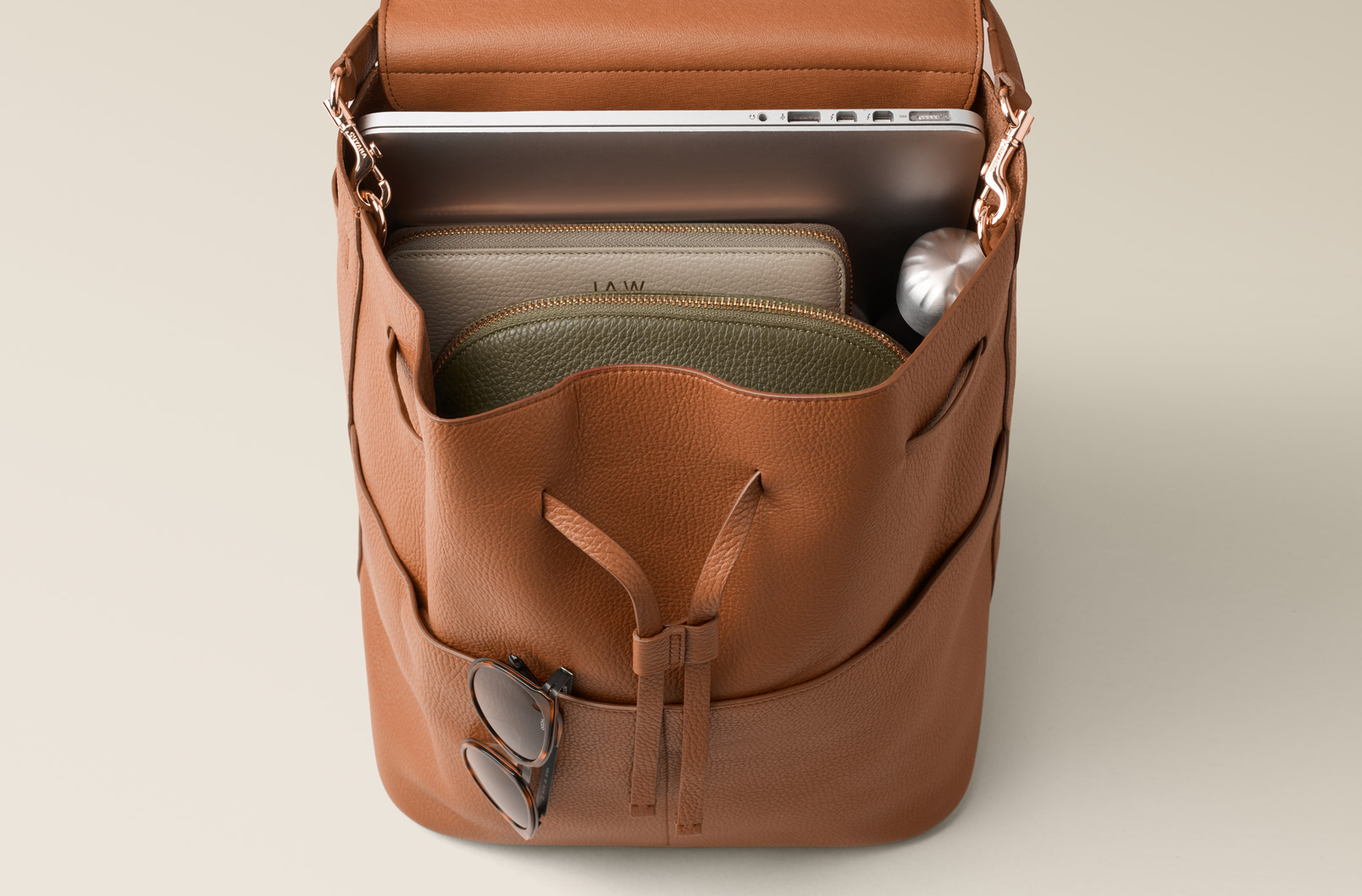 Interior image of Large Leather Backpack with Laptop and notebook inside