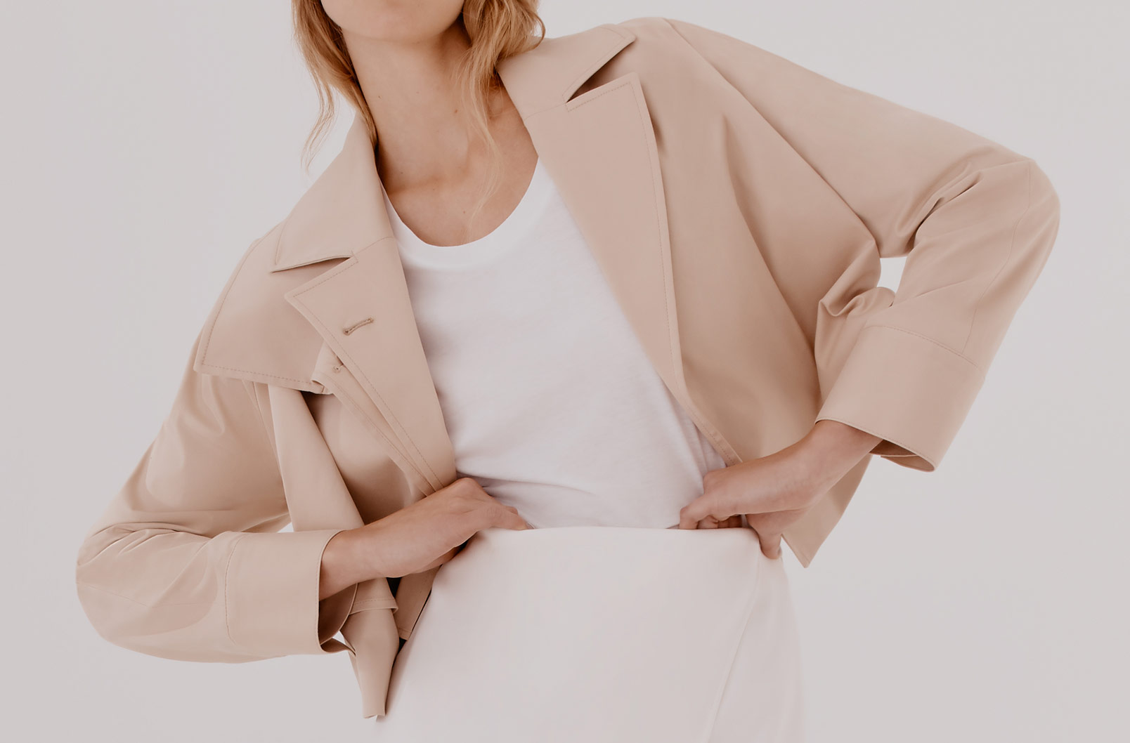 Model wearing Cuyana Cropped Trench