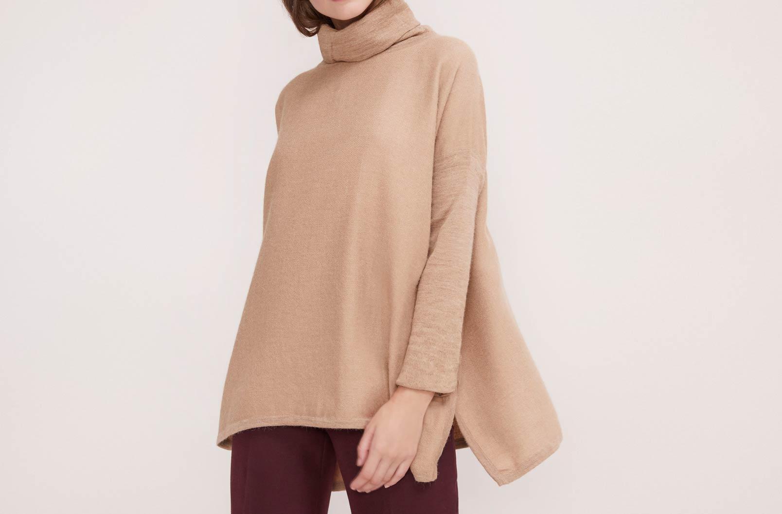 Model wearing Baby Alpaca Oversized Turtleneck Sweater