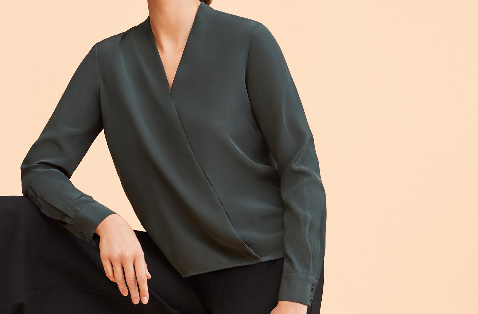 Model wearing Cuyana Silk Wrap Blouse