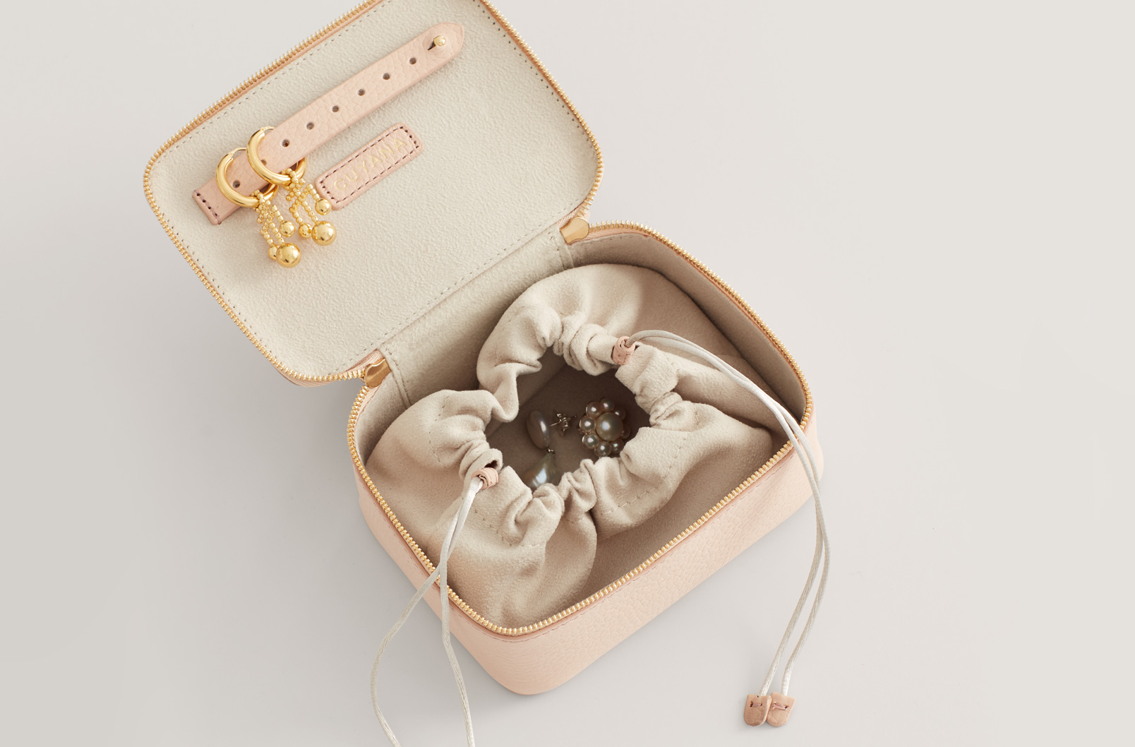 Cuyana Mini Jewelry Case interior with cinched felted pouch
